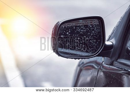 Close Up Of Water Droplets On The Car Side Mirror After Rain With Copy Space, Causing Danger While U
