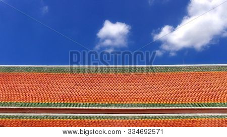 Colour Asian Style Temple Roof Tiles With White Cloud And Blue Sky Background