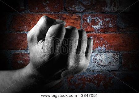 Fist Against Brick Wall