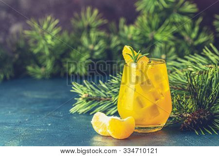 Yellow Orange Cocktail With Tangerine And Rosemary In Glass On Dark Blue Concrete Background Decorat