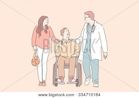 Disability, Injury, Health, Support Concept. Young Man In Wheelchair With His Wife Talking To Physio