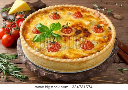 Freshly Baked Homemade Pie Quiche Lorraine On A Wooden Table. Traditional French Pastries