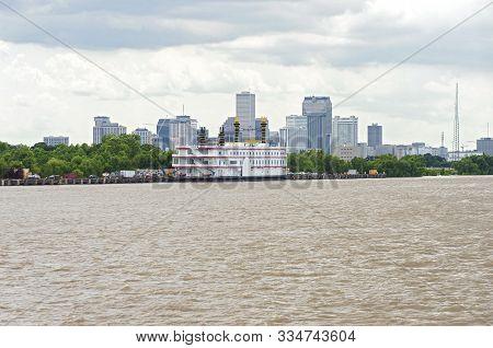 New Orleans, La/usa -june 14, 2019: Riverboat Vessel At Pier Along Mississippi River Banks And Downt