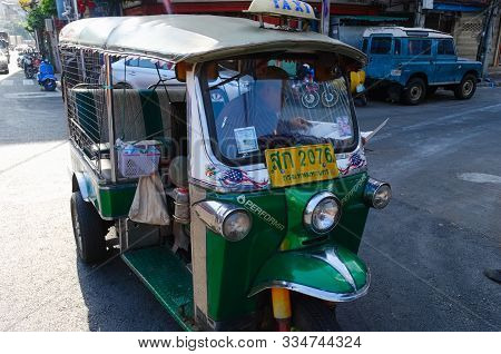 Bangkok, Thailand - December, 2015: Green Tuk Tuk Taxi Parked On The Street And Waiting For Tourists