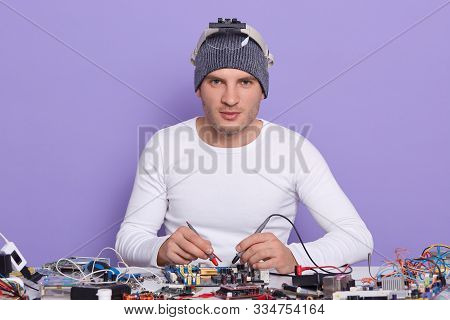 Caucasian Young Man Dresss White Shiert And Gray Cap, Digital Electronic Engineer Repairing Computer