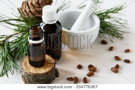 Natural Cosmetics, Eco Product, Composition Glass Bottles With Cedar Oil, Pine Nuts, Mortar, Cedar E