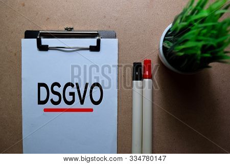 Dsgvo Write On A Paperwork. Isolated On Wooden Table