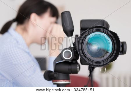 Close Up Image Of Dslr Camera On Tripod With Working Woman Photographer Or Designer On Back Screen A