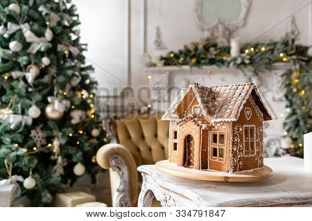 Postcard Gingerbread House. Defocused Lights Of Christmas Tree. Holiday Mood. Christmas And Happy Ne