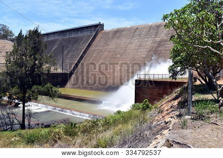 A General View Of The Tinaroo Falls Dam Showing Water Release For Irrigation Downstream