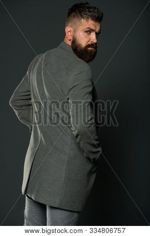 Bearded Man With Moustache And Beard Unshaven Face. Hipster Wearing Casual Outfit. Clothes Shop. Men
