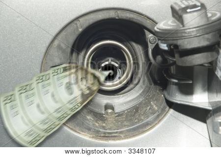Money Flowing Into Gas Tank