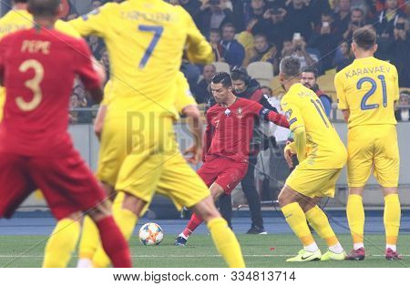 Kyiv, Ukraine - October 14, 2019: Cristiano Ronaldo Of Portugal (in Red) Performs A Free Kick During