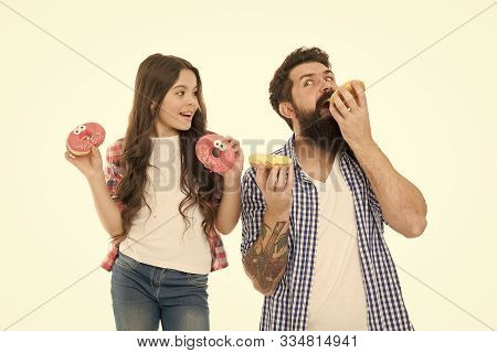 We Have Passion For Tasty Doughnuts. Father And Small Daughter Eating Glazed Doughnuts. Bearded Man