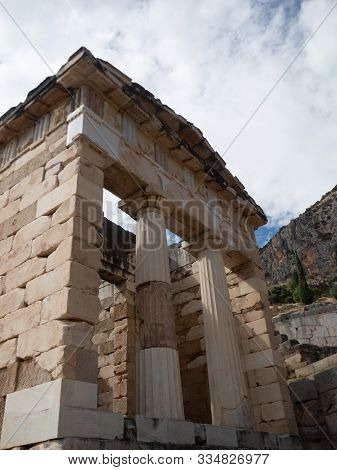 The Rebuilt Athenian Treasury With Doric Columns And Stone Block Construction At Delphi In Greece.