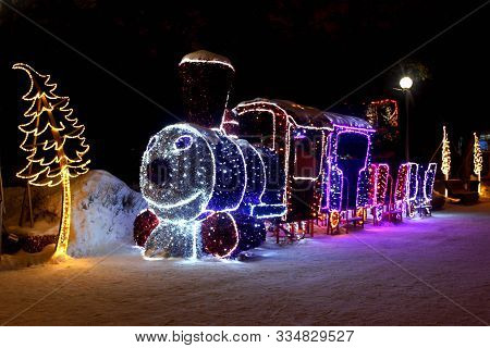 Dimensional Figure In The Form Of A Toy Christmas Locomotive With Cars And Pine Tree, Made Of Multic