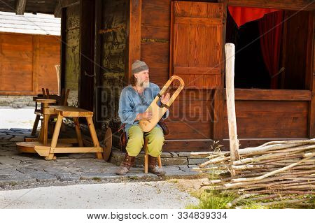 Gudvangen, Norway - June 13 - The Viking Musician  In National Clothes In The Viking Village Museum.