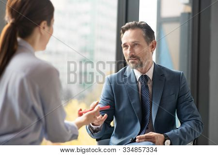 Affluent Entrepreneur Speaking With Journalist While Giving Interview