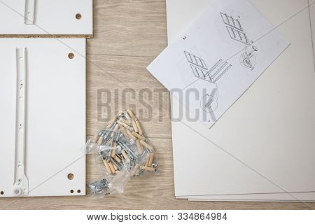 Nizhnevartovsk, Russia - August 25, 2019: Furniture Assembly Parts And Tools For Self Assembly Furni