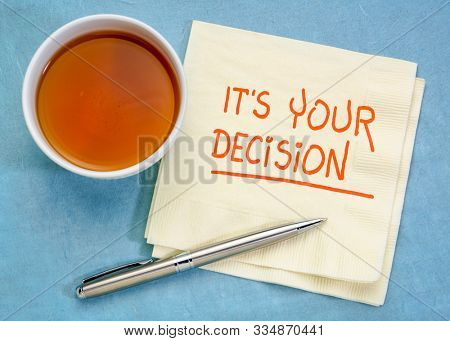 It is your decision note - handwriting on napkin with a cup of tea - decision making and responsiblity concept