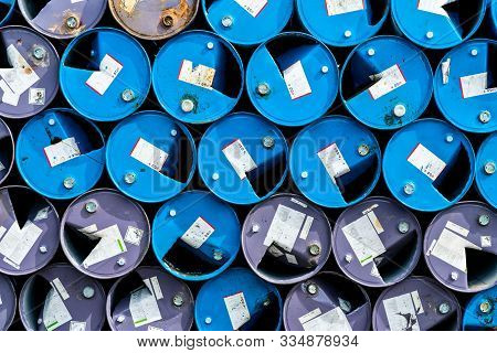 Old Chemical Barrels. Blue And Purple Oil Drum. Steel Oil Tank. Toxic Waste Warehouse. Hazard Chemic