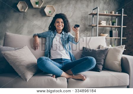 Photo Of Pretty Dark Skin Wavy Lady Homey Mood Holding Tv Remote Control Changing Channel Searching