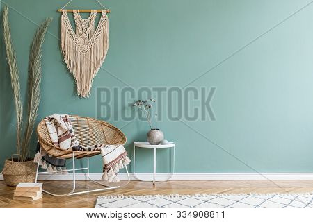Stylish Minimalistic Interior Of Living Room With Design Rattan Armchair, Palm Leaf In Basket, Plaid