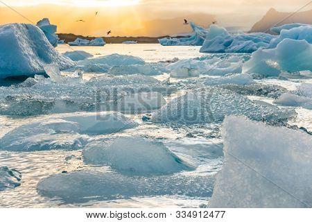Ice Lagoon. Icebergs Floating In Jokulsarlon Glacier Lagoon Lake At Sunset. South Iceland, Jokulsarl