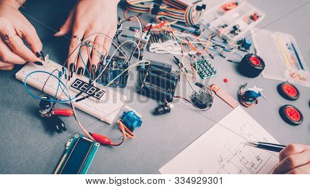 Diy Rc Car Model. Female Engineer, Electronic Components, Circuit Wires