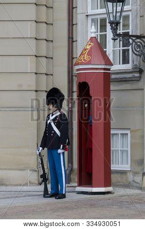 Copenhagen, Denmark, September 2012 - A Danish Royal Guard Standing Outside His Sentry Box In Copenh