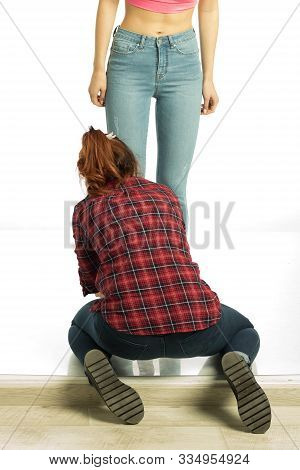 Picture Of Female Assistant Helping Model