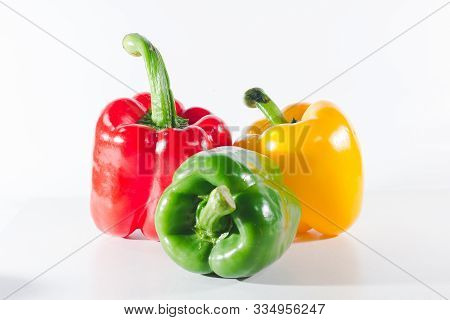 Sweet peppers are on a white background, sweet peppers are used for cooking and to be eaten fresh, s