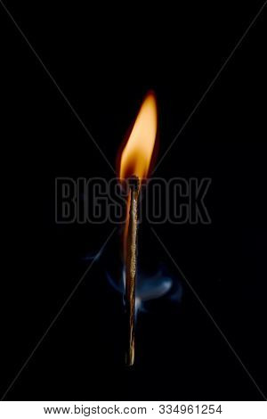 Safety Match On Black Background With Flaming Head