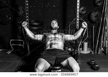 Chest Muscle Workout, Young Strong Focused Fit Muscular Man Chest Bench Press Stretching Cross Worko