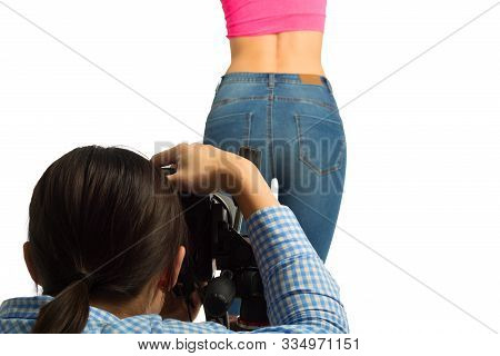 Back View Of Young Female Photographer