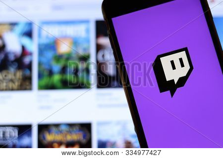 Los Angeles, California, Usa - 21 November 2019: Twitch Tv Logo On Phone Screen With Icon On Laptop
