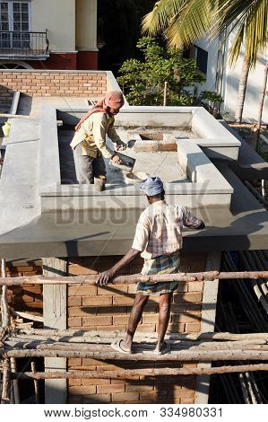 Bangalore, India - January 26, 2014. Construction Workers Build An Apartment Block In Bengaluru, For
