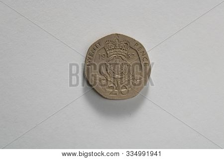 A Portrait Of A Used Twenty Pence Piec Isolated Over A White Background