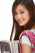 Portrait of friendly Asian High school girl student with backpack holding notebooks and composition book poster