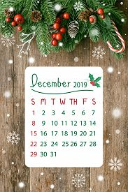 Christmas Calendar Wood Plank In Vertical With Pine Leaves And Cones, Holly Balls, Snow And Candy Ca