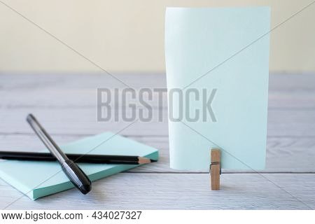 Blank Sticky Note With Laundry Clip Stack Of Colorful Paper Pen Placed On Table. Empty Piece Of Shee