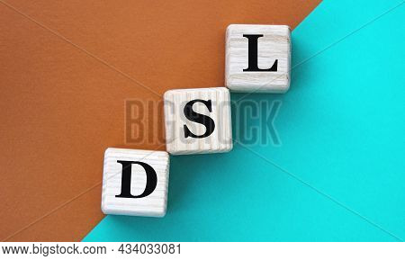 Dsl (domain Specific Language) - Acronym On Wooden Cubes On A Multi-colored Background. Internet Con