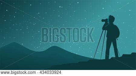 A Man Tourist Photographs The Starry Sky