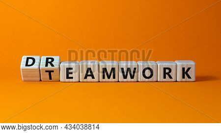 Teamwork And Dream Work Symbol. Turned Wooden Cubes And Changed The Word 'dreamwork' To 'teamwork'.