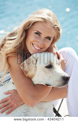 Portrait of young girl hugging her dog poster