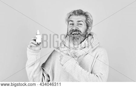 Fast Recovery. Cold Flu Remedies. Runny Nose And Symptoms Of Cold. Man Scarf Hold Nasal Spray. Medic
