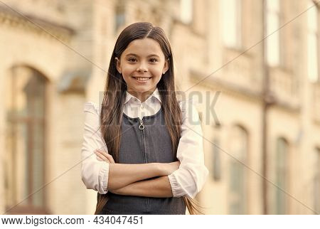 Confident Happy Kid Smile In School Uniform Keeping Arms Crossed Outdoors, Confidence