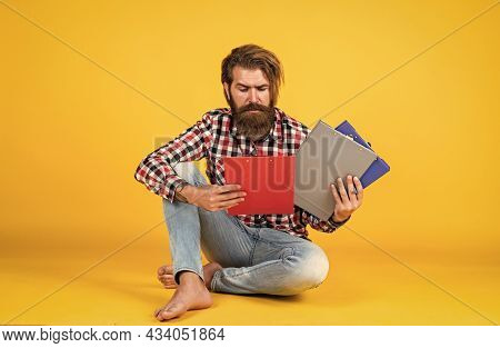What Should I Do With This. Casual Styled Man Writing In Document Folder. Paper Work Concept. Typica
