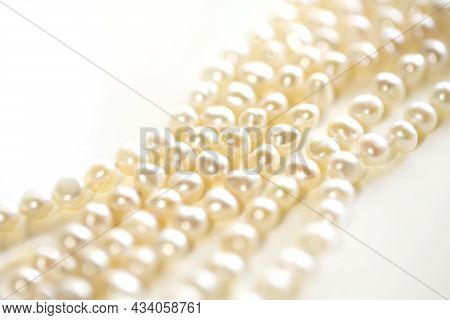 Beads From Pearls, On A White Background And Copy Space. Close Up.