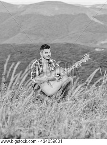 Acoustic Music. Man With Guitar On Top Of Mountain. Summer Music Festival Outdoors. Playing Music. S